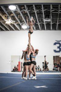 girls-cheerleading-squad-doing-stunt-during-practice-cyclone-2