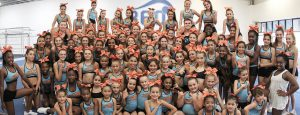 group-of-young-female-cheerleaders-posing-for-a-group-photo-at-gymnastics-gym-new-slider1-940x360