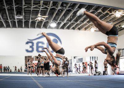 two-female-cheerleaders-doing-flips-during-practice-cyclone-3