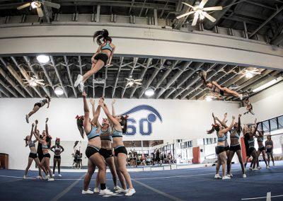 young-female-cheerleaders-performaning-tsunami-stunts-during-practice-tsunami-2